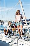 Young couple enjoying vacation on sailboat