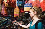 Tourist shopping on the Khaosan Road Market in Bangkok, Thailand, Southeast Asia, Asia