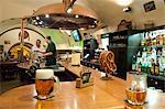 Barman pouring beer at bar of U Vejvodu Pub, Old Town, Prague, Czech Republic, Europe