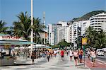 People walking on Copacabana beach promenade, Rio de Janeiro, Brazil, South America