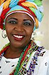 Portrait of a Bahian woman in traditional dress at the Pelourinho district, Salvador, Bahia, Brazil, South America