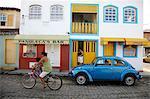 People riding a bicycle, Parati, Rio de Janeiro State, Brazil, South America