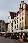 Cafes and restaurants under historic buildings, Town Hall Square (Raekoja Plats), UNESCO World Heritage Site, Tallinn, Estonia, Europe