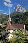 Church in St. Cristina overlooked by Sassolungo Mountain, Gardena Valley, Bolzano Province, Trentino-Alto Adige/South Tyrol, Italian Dolomites, Italy, Europe