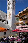 Church and cafe, Alleghe, Belluno Province, Veneto, Dolomites, Italy, Europe
