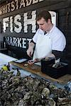 Oyster seller, Whitstable, Kent, England, United Kingdom, Europe