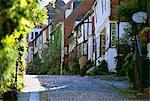 View along cobbled Mermaid Street, Rye, East Sussex, England, United Kingdom, Europe