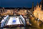 Ice Rink and Christmas Market in the Market Square, Bruges, West Vlaanderen (Flanders), Belgium, Europe