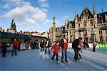 Christmas Ice Rink in the Market Square, Bruges, West Vlaanderen (Flanders), Belgium, Europe