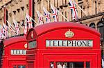 Red telephone boxes opposite Harrod's, Knightsbridge, London, England, United Kingdom, Europe