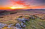 A colourful dawn on Chinkwell Tor in Dartmoor National Park, Devon, England, United Kingdom, Europe