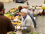 vendors sell vegetables at village farmers market, Cortona, Tuscany, Italy