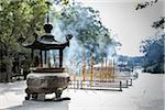Burning Incense, Po Lin Monastery, Ngong Ping Plateau, Lantau Island, Hong Kong, China