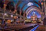 Tourists inside Notre-Dame Basilica, Montreal, Quebec, Canada
