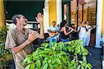 Man Dancing to Music from Band Playing at Taberna de La Muralla, Plaza Vieja, Havana, Cuba