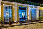 Waitress Looking Out Door of Restaurant Museo at Night, Trinidad, Cuba