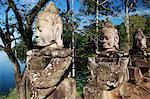 Stone carving of deities near a lake, Angkor Wat, Cambodia