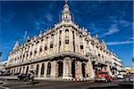 Traffic Passing by Great Theatre of Havana (Gran Teatro de La Habana) with Bright Blue Sky, Havana, Cuba