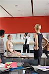 Designers examining dress in studio