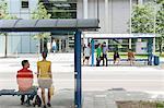 People waiting at bus stops