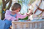 Girl unpacking picnic basket outdoors