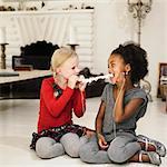 Girls eating popcorn off string