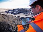 Ecologist examining surface coal mine