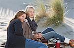 Smiling women relaxing on beach