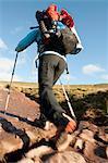 Hiker walking up rocky path