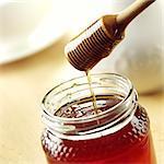 Honey Dipper over a jar of Honey