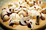 Button Mushrooms Chopped on a Cutting Board