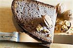 An arrangement of walnut bread, a knife and walnuts