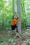 Hispanic boy on ropes course