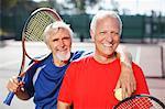 Older men smiling on tennis court