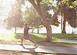 Man practicing yoga in park