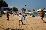 Men playing foot volleyball at Porto da Barra beach, Salvador (Salvador de Bahia), Bahia, Brazil, South America