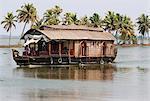 Traditional Kettuvallom (private houseboat) travelling along the Kerala Backwaters, Kerala, India, Asia