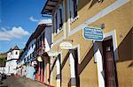 Row of shops and Catedral Basilica da Se, Mariana, Minas Gerais, Brazil, South America
