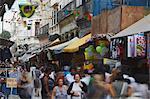 People walking along pedestrianised street of Saara district, Centro, Rio de Janeiro, Brazil, South America