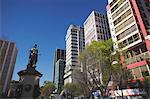 Statue and skyscrapers on Avenida 16 de Julio (El Prado), La Paz, Bolivia, South America