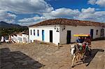 Horse-drawn carriage on cobblestone street, Tiradentes, Minas Gerais, Brazil, South America