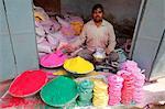 Man selling colored powders for Holi festival, Barsana, Uttar Pradesh, India, Asia