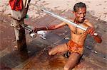 Man using a water pump for bathing, Mathura, Uttar Pradesh, India, Asia