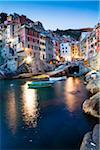 Clifftop village of Riomaggiore at dusk, Cinque Terre National Park, UNESCO World Heritage Site, Liguria, Italy
