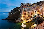 Clifftop village of Riomaggiore at dawn, Cinque Terre National Park, UNESCO World Heritage Site, Liguria, Italy