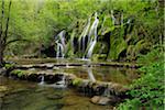 Waterfall cascading over green moss, Cascade des Tufs, Arbois, Jura, Jura Mountains, Franche-Comte, France