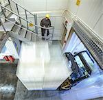 Fork lift truck entering factory