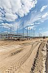 Construction vehicle tracks beside construction frame