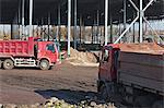 Parked dumper trucks at construction site