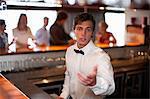 Waiter taking order at restaurant bar